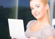 Happy businesswoman with laptop computer Royalty Free Stock Photo
