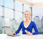 Happy businesswoman with laptop and credit card Royalty Free Stock Image