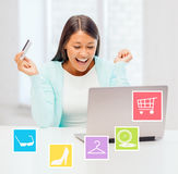 Happy businesswoman with laptop and credit card Royalty Free Stock Photo