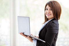 Happy businesswoman with a laptop Royalty Free Stock Photo