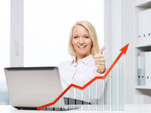 Happy businesswoman with laptop showing thumbs up Royalty Free Stock Photos