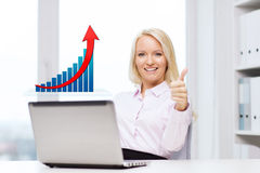 Happy businesswoman with laptop showing thumbs up Stock Photography