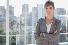 Happy businesswoman beside large window Royalty Free Stock Photos