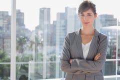 Happy businesswoman beside large window Royalty Free Stock Photos