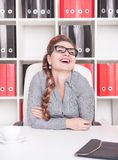 Happy businesswoman laugh. Working in the office Royalty Free Stock Image