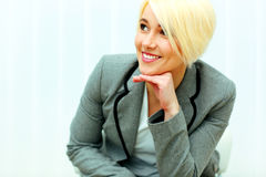 Happy businesswoman looking away at copyspace Stock Images