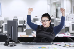 Happy businesswoman looking at computer Royalty Free Stock Image
