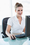 Happy businesswoman looking at her computer screen Stock Photography