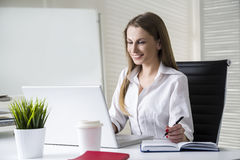 Happy businesswoman looking at laptop screen Stock Photos