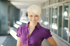 Happy businesswoman looking and smiling at camera Stock Photo