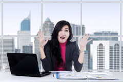 Happy businesswoman looks shocked Royalty Free Stock Photo
