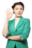 Happy businesswoman making an ok sign Stock Photo