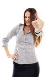 Happy businesswoman making thumbs up sign Stock Photo