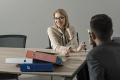 Happy businesswoman and manager at work process. Woman boss with financier in office. Sensual woman discuss company. Happy businesswoman and manager at work royalty free stock photo