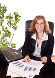 Happy businesswoman in office Stock Photo