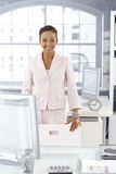 Happy businesswoman in office Stock Photography
