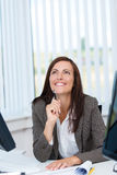 Happy businesswoman in the office Royalty Free Stock Photography
