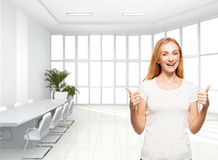 Happy businesswoman in the office. Young smiling female inside Royalty Free Stock Photos