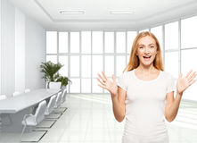 Happy businesswoman in the office. Young smiling female inside Royalty Free Stock Photography