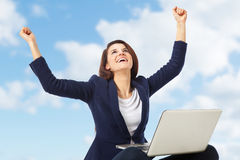 Young businesswoman celebrating a success working with laptop Royalty Free Stock Photography