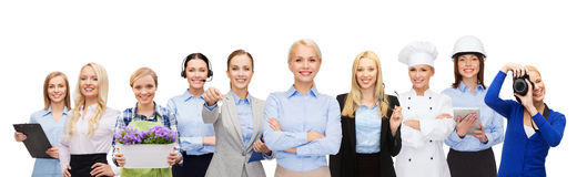 Happy businesswoman over professional workers. People, profession, qualification, employment and success concept - happy businesswoman over group of professional stock images