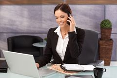 Happy businesswoman on phone call Stock Photo