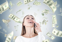 Happy businesswoman on phone, dollar rain Royalty Free Stock Photography
