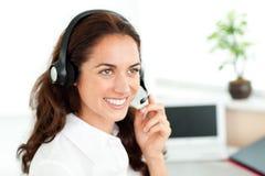 Happy businesswoman on phone with earpiece Stock Photo