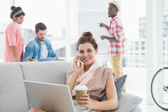Free Happy Businesswoman Phoning And Using Laptop On Couch Royalty Free Stock Photos - 49309558