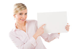 Happy businesswoman pointing aside at empty banner Royalty Free Stock Images