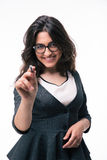 Happy businesswoman pointing on camera with pen Stock Photo