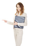 Happy businesswoman pointing with clipboard. Royalty Free Stock Images