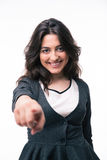 Happy businesswoman pointing finger on camera Royalty Free Stock Images