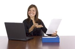 Happy businesswoman pointing report Royalty Free Stock Photos