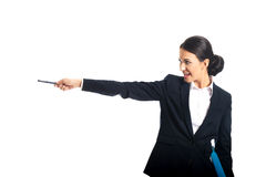 Happy businesswoman pointing to the left by pen Royalty Free Stock Photography