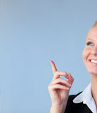 Happy Businesswoman pointing upwards Stock Photography