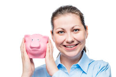 Happy businesswoman portrait with piggy bank full of coins. On a white background Royalty Free Stock Photography
