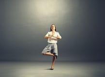Happy businesswoman practicing yoga Stock Photo