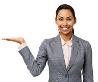 Happy Businesswoman Presenting Invisible Product Stock Photography