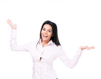 Happy businesswoman presenting something on palm Stock Images