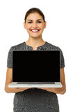 Happy Businesswoman Promoting Laptop Royalty Free Stock Image
