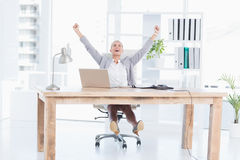 Happy businesswoman with raised arms Stock Photos