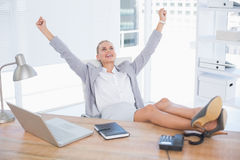 Happy businesswoman with raised arms. In her office Royalty Free Stock Photography