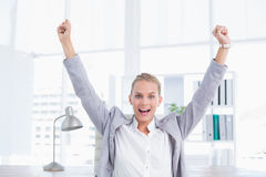 Happy businesswoman with raised arms Royalty Free Stock Photo