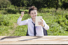 Happy businesswoman raises her hand in a gesture of success Royalty Free Stock Photos