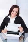 Happy Businesswoman Reading Document Stock Image