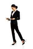 Happy businesswoman reading her notes Stock Photo
