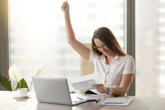 Happy businesswoman reading letter in office stock photos