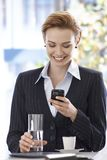 Happy businesswoman reading text message Royalty Free Stock Photo