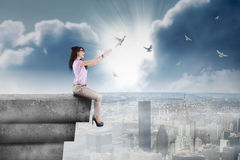Happy businesswoman releasing birds Royalty Free Stock Images